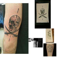 Geometric pirate skull arm tattoo
