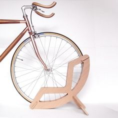 Wooden Bike stand  Your beautiful bicycle deserves more than leaning against the wall when at home. This Bike Stand made from solid wood will protect it from damages and will look elegant inside and outside your home.  Purchase it on our website !