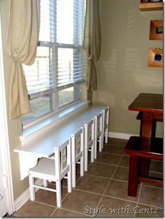 smart! child-sized chair and shelf/ledge mounted at corresponding height. // window space