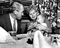 Jimmy Stewart having lunch with Shelley Winters and her baby daughter