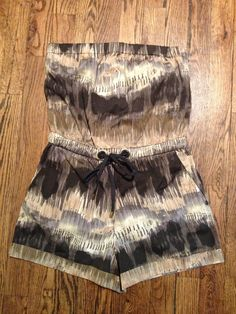 Brown Tye-Dye Romper from Armani Exchange ($49). Size Small.     For more information or to purchase, email thriftshare@gmail.com. Visit our website at www.thriftshare.com