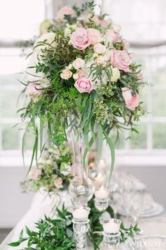 A Lush, Soft-Hued Styled Shoot Inspired by an Airy, Enchanted Garden featuring lovely blush and pink flower arrangements