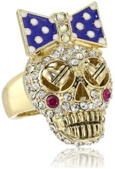 """Betsey Johnson """"Ivy League"""" Crystal Stretch Ring, Size 7.5 Betsey Johnson. $55.00. Handmade rings may range a 1/2 size up or down Made in CN. Ring Shank Width=6-11mm. Handmade rings may range a 1/2 size up or down. Gold tone skull with crystal accents and polka dot bow, gold tone stretch ring shank. Items that are handmade may vary in size, shape and color"""