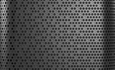Beolit 12 | Close up detail of the grille on B&O's Beolit 12, a useful reference for creating a random pattern of holes and texture, caisdesign.com