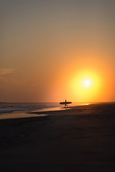 Sun surfer - A lone surfer on the Pacific coast of Chiba, Japan