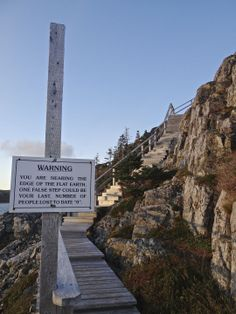 Newfoundland: A warning sign greets visitors to Fogo Island's Brimstone Head, which members of the Flat Earth Society believe is one of the four corners of the earth. Oh The Places You'll Go, Places To Visit, Beautiful Vacation Spots, Flat Earth Society, Atlantic Canada, Holiday Places, Newfoundland And Labrador, Island Tour, Prince Edward Island