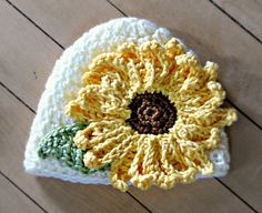 You can use any basic hat pattern you are use to and attach this sunflower.