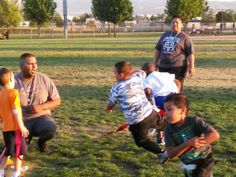 My HoneyChild Isreal Jayco Very center of photo. Blue camouflage design t-shirt and black jeans  @ practice flag football  game. April 2015 Original picture without any editing.