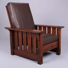 Gustav Stickley #332 slatted Morris chair.  Unsigned.  Original finish except arm surfaces.  39″h x 31.5″w x 38″d