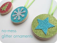 LOVE these no-mess glittery ornaments! Wooden discs, ribbon and glittery scrapbook paper. Use the Cricut to cut out shapes/letters. Let kids pick their combo of shape/letter and background color. Easy, pretty, no mess! By homemadebyjill.blogspot.com