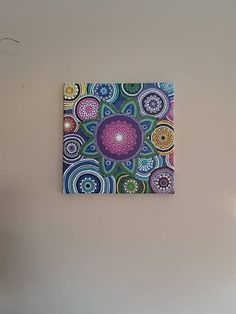 12×12 canvas. This is hand painted using different sized dotting tools one by one. I used various colors of acrylic paint.
