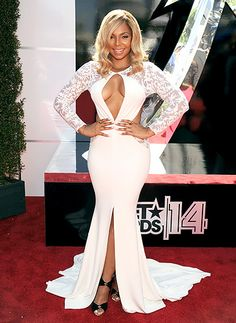 Ashanti chose a cream Michael Costello dress with lace sleeves for the 2014 BET Awards.