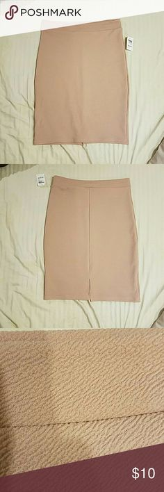 Tan textured igh waisted pencil skirt NWT textured tan skirt. Great for formal wear or a night out. Stretchy material. Charlotte Russe Skirts Pencil