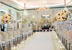 Aisle arrangements at Claridge's - white hydrangeas and orchids White Wedding Flowers, Classic White, Orchids, White Hydrangeas, Chandelier, Ceiling Lights, Table Decorations, Dressing, Live