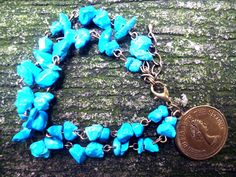 Plumeria Blue Chip Layer Bracelet Blue chip beads in vintage chain with vintage charm  Like us on https://www.facebook.com/plumeriajewelry to purchase.