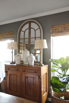 Holly Mathis Interiors: Young Houston family's home - I love the arched mirror!