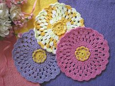"A FAVE. 4/5 sc around petals, sl st in existing sc's. Makes flower more dimensional.  Getting into pot holders & trivets lately. And baby hats??? Go figure. :)   ***     Miss Abigail's Hope Chest: ""Vintage Rose"" Granny Round Crocheted Dishcloth"