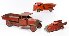 Lot 561: Pressed Steel Toy Dump Truck Assortment; Three items including a large unmarked red dump truck, a Richmond truck and a small Wyandotte truck