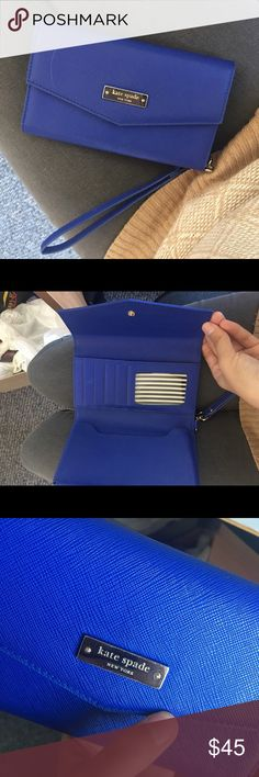 Kate Spade wristlet Super elegant and beautiful royal blue wristlet! Has been gently used and the only flaw is the scratch on the front, however it's barely noticeable. Also some gentle use around the wristlet but not noticeable at all. It fits an iPhone 6 Plus without a case and has card slots and a cash pocket kate spade Bags Clutches & Wristlets