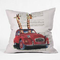 Coco de Paris 2 Giraffes In A French Car Throw Pillow | DENY Designs Home Accessories
