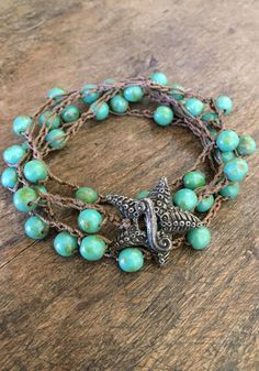 Beautiful patinaed turquoise Czech beads are crocheted onto sandy brown nylon cord accenting the color of these lovely beads.