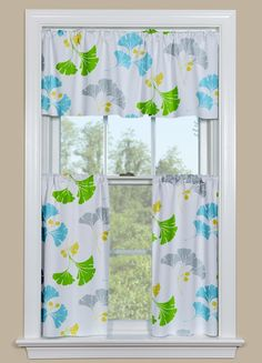 Vibrant Hues Make For Lovely Modern Kitchen Curtain. The Gingko Print  Features Shades Of Blue, Green, Grey And Gold Against A White Background.