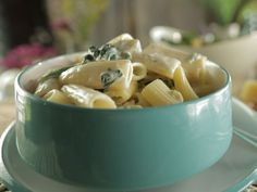 Spinach and Artichoke Dip Pasta: Damaris Phillips combines rigatoni with this chip-dipping favorite for the ultimate comfort food dish.