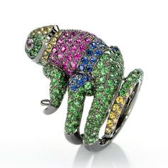 Ring set with pavé tsavorite garnets, blue, pink and yellow sapphires and two rubies, in blackened gold by Boucheron
