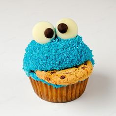 A Cookie Monster Cupcake and appropriately enough eating a cookie.