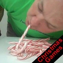 Christmas game - using a candy cane in your mouth, pick up as many other candy canes as you can in a certain amount of time and you can't use your hands! Lets do it up!