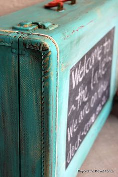 DIY. Repurpose an old suitcase -- welcome sign - Chalkboard. Actually there are many old 'finds' that you can repurpose this way. Great idea.