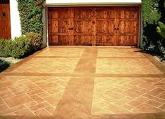 Concrete driveways are overrated? With these decorative concrete driveway options, there's no reason for concrete to be boring. Stamped Concrete Patterns, Stamped Concrete Driveway, Concrete Driveways, Concrete Floors, Decorative Concrete, Walkways, Concrete Stamping, Cement Driveway, Circular Driveway