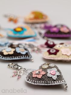 Hearts- Bag Tags / Keychains. Scrap fabric, buttons, beads, & crochet embellishments. Inspiration only