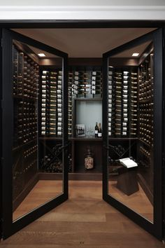 The double glass doors on this wine cellar add a sort of elegance to the libations. Cave A Vin Design, Wine Cellar Design, Wine Cellar Modern, Glass Wine Cellar, Home Wine Cellars, Double Glass Doors, Wine Tasting Room, Home Bar Designs, Wine Wall