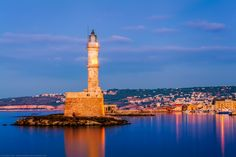 Blue Hour at the Venetian Lighthouse, Chania, Crete, Greece by Joe Daniel Price on Blue Hour, Cn Tower, Venetian, Crete Greece, Statue Of Liberty, Paris Skyline, Beautiful Places, Island, Night