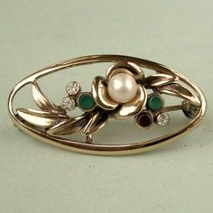 Vintage 1980s Majorica pearl gold plated sterling silver brooch.