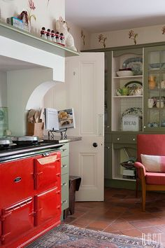 built out around the aga so that you can have a shelf on top. maybe hang stuff r. Cosy Kitchen, Kitchen Mantle, Aga Kitchen, Kitchen Decor, Kitchen Design, Kitchen Cabinets, Kitchen Ideas, Kitchen Colour Schemes, Kitchen Colors