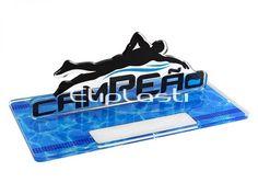 Troféu de acrílico para premiação de natação. Desenvolvido em acrílico cristal e impressão digital U.V. Cores, textos e tamanho pode ser personalizado de acordo com a necessidade do cliente.