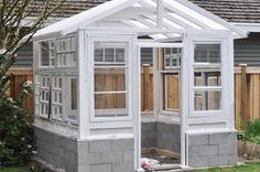 build a greenhouse from vintage windows, gardening, home improvement, outdoor living plans old windows Build a Greenhouse From Vintage Windows Window Greenhouse, Backyard Greenhouse, Small Greenhouse, Greenhouse Plans, Greenhouse Wedding, Pallet Greenhouse, Homemade Greenhouse, Vintage Windows, Old Windows