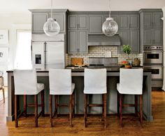 Elegant Neutral Kitchen - Birmingham interior designer Lindsey Bond Meadows simplified the space by hanging two large glass globes that don't block kitchen views. Updated Kitchen, New Kitchen, Kitchen Dining, Kitchen Layout, Room Kitchen, Neutral Kitchen, Transitional Kitchen, Kitchen White, Black Countertops