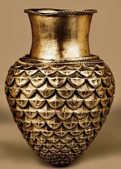 The rhytonized amphora from the Mogilanovo's mound is 14 cm high, with a diameter of 6 cm, made of silver and dating back to 339 B.C. According to the scientists it is part of an Odrysian royal set. Its body is formed as a fir-cone. The fir-cone is part of the Dionysius scepter which is engirdled with ivy and vine leaves and ends up with a fir-cone. On the scales of the cone one can see the stylized relief patterns of sun symbols.