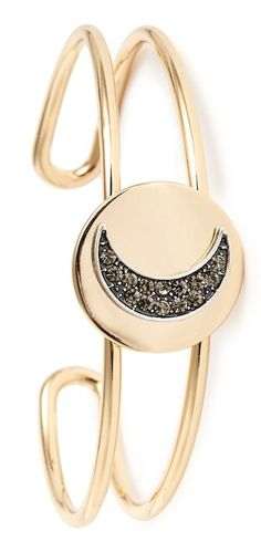 A dark, crystal-embellished moon rises on this intriguing open cuff with a bright golden finish.