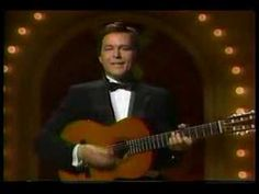 Jim Stafford. I don't like spiders and snakes. (smothers brothers show).