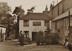 The Sussex Arms pictured in 1954.  Image from the National Brewery Heritage Trust's collection.