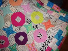 "This quilt from the ""Talking Lunchbox Quilts"" blog has the most wonderful black and white fabrics -- crossword puzzles, letters, newspaper, etc. I love them!"