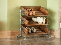 Sitting in the foyer of DIY Network's Blog Cabin 2015, this industrial-style shoe rack is a beautiful and unique way to encourage guests to take off their shoes and stay while. The craftsmen at Reformed Wood built this one-of-a-kind piece from repurposed pipes and shaker maple wood.