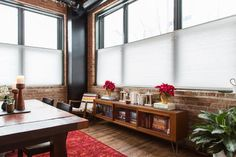 Kristin and Nathan's warm, industrial modern Chicago loft is beautiful any day of the year, but decorated for the holidays it's even lovelier.