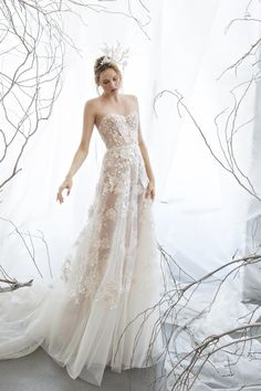 Strapless A-line gown with hand floral appliqués. Color: Ivory Nude