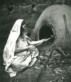 "A woman, making tradional bread, in Tafarnout"" Traditional oven"".  Tiznit/ Morocco."
