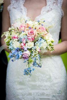 Ultra Romantic Bridal Bouquet Comprised Of: White Freesia, White Lily Of The Valley, White Roses, Lavender Roses, Pink Roses, Pink Tulips, Blue Forget-Me-Nots, Light Blue Delphinium